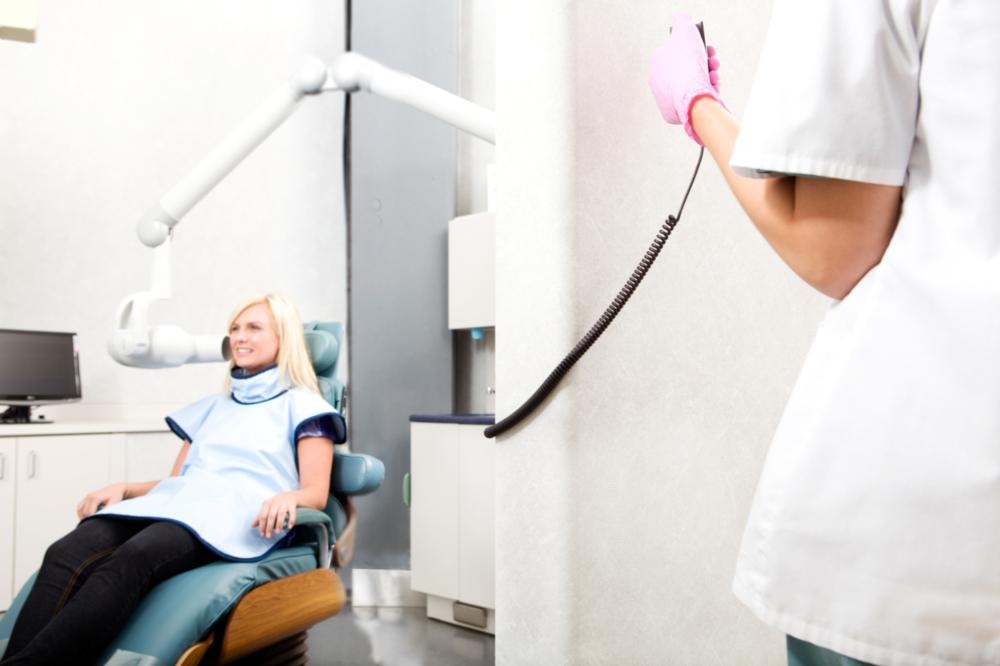 an image of a woman getting a dental x-ray taken | Dental X-rays Lafayette, LA