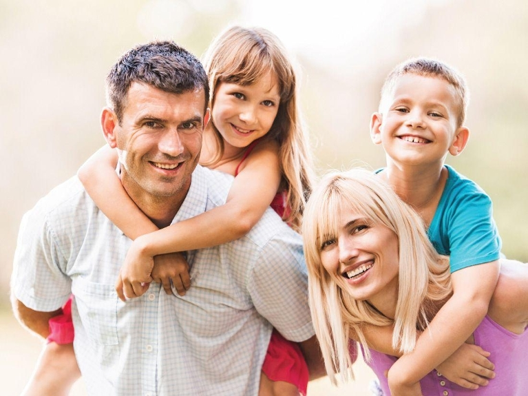 family smiling together | dentist lafayette la